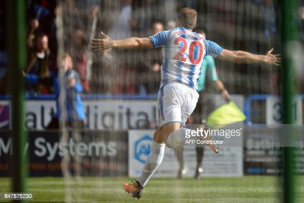 Huddersfield Town's Belgian striker Laurent Depoitre celebrates after scoring the opening goal of the English Premier League football match between...