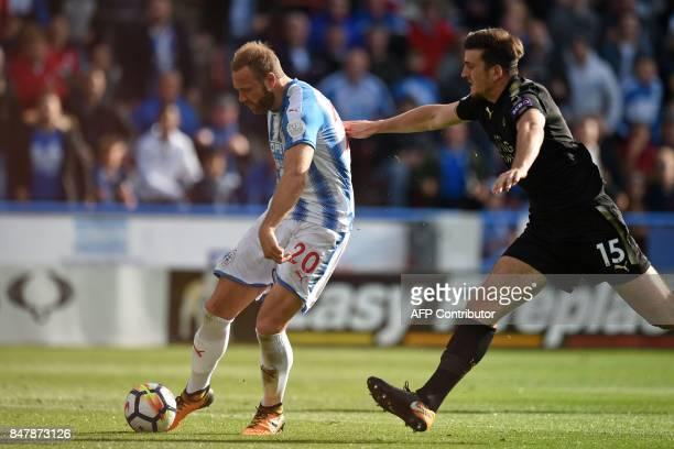 Huddersfield Town's Belgian striker Laurent Depoitre shoots to score the opening goal of the English Premier League football match between...