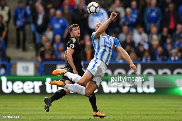 Huddersfield Town's Belgian striker Laurent Depoitre vies with Leicester City's English defender Ben Chilwell during the English Premier League...