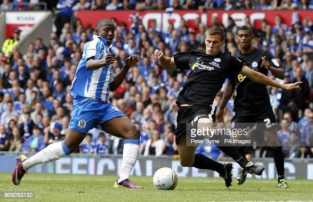 Huddersfield Town's Benik Afobe and Peterborough United's Ryan Bennett battle for the ball