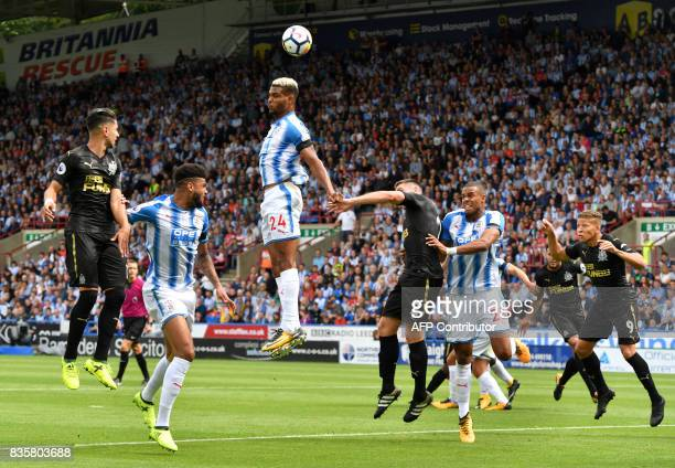 TOPSHOT Huddersfield Town's Beninese striker Steve Mounie clears the ball during the English Premier League football match between Huddersfield Town...