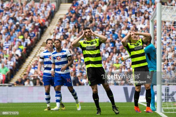 Huddersfield Town's Christopher Schindler and Huddersfield Town's Michael Hefele react after a missed chance during the EFL Sky Bet Championship...