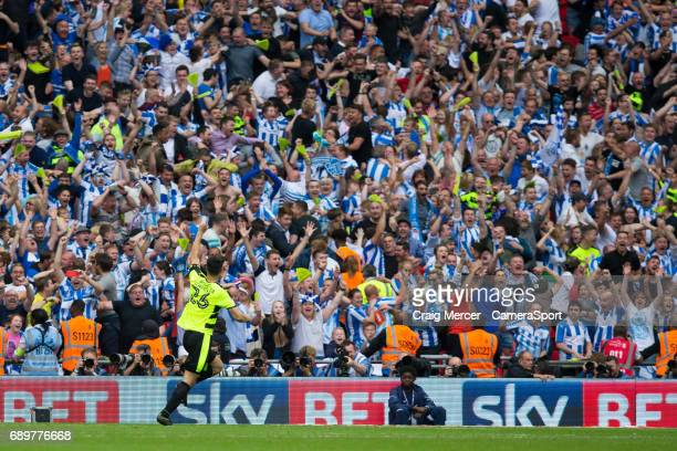 Huddersfield Town's Christopher Schindler celebrates scoring the winning penalty in the shootout during the EFL Sky Bet Championship PlayOff Final...