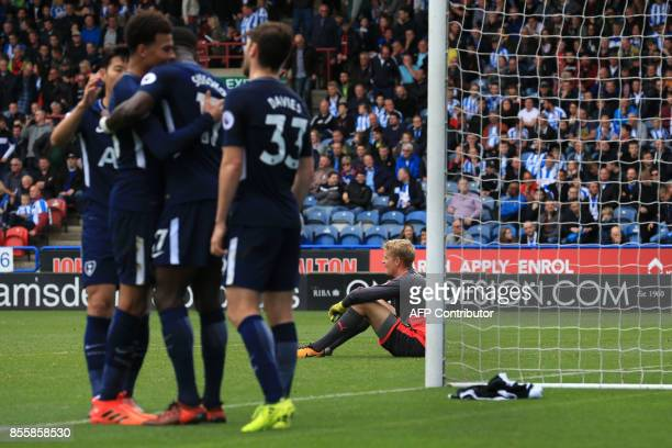 Huddersfield Town's Danish goalkeeper Jonas Lossi reacts as Tottenham Hotspur's French midfielder Moussa Sissoko celebrates scoring the team's fourth...