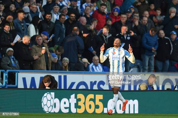 Huddersfield Town's Dutch midfielder Rajiv van La Parra celebrates after scoring during the English Premier League football match between...