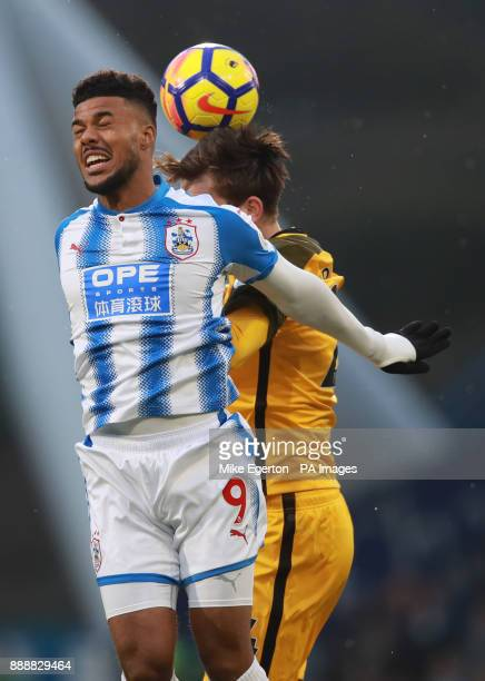 Huddersfield Town's Elias Kachunga and Brighton Hove Albion's Davy Propper battle for the ball during the Premier League match at the John Smith's...