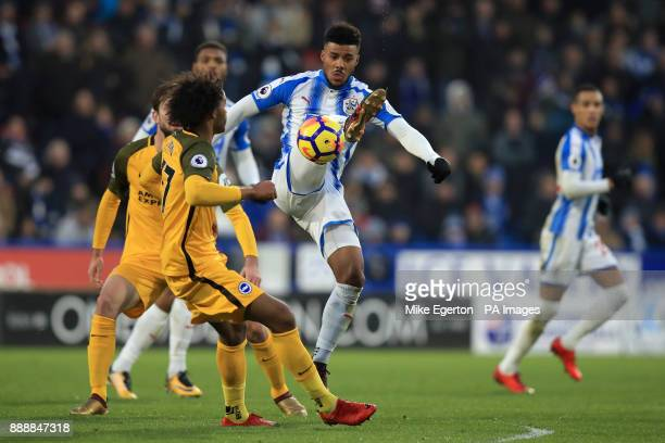 Huddersfield Town's Elias Kachunga and Brighton Hove Albion's Izzy Brown battle for the ball during the Premier League match at the John Smith's...