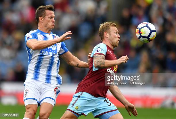 Huddersfield Town's Elias Kachunga and Burnley's Scott Arfield during the Premier League match at Turf Moor Burnley