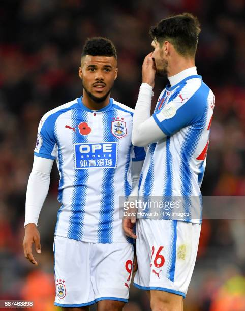 Huddersfield Town's Elias Kachunga and Huddersfield Town's Christopher Schindler react after the final whistle during the Premier League match at...