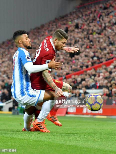 Huddersfield Town's Elias Kachunga and Liverpool's Alberto Moreno battle for the ball during the Premier League match at Anfield Liverpool