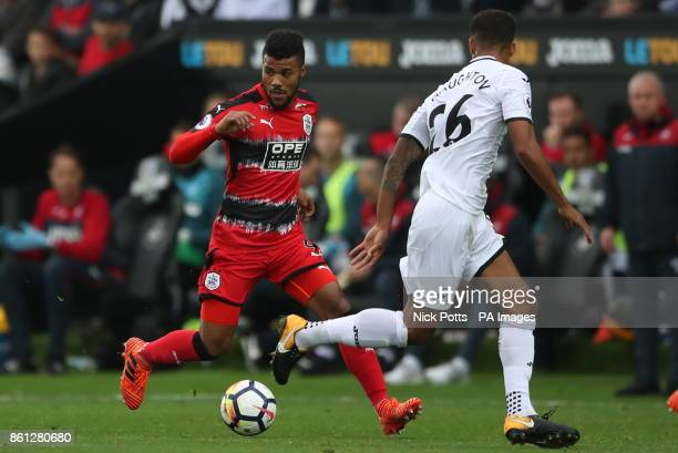 Huddersfield Town's Elias Kachunga and Swansea City's Kyle Naughton battle for the ball during the Premier League match at the Liberty Stadium Swansea