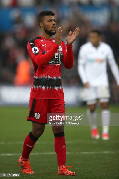 Huddersfield Town's Elias Kachunga applauds supporters after the final whistle during the Premier League match at the Liberty Stadium Swansea