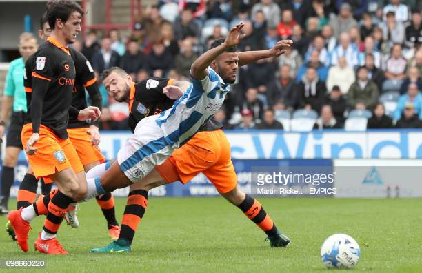 Huddersfield Town's Elias Kachunga battles for the ball with Sheffield Wednesday's Daniel Pudil