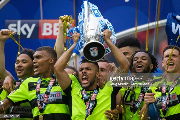 Huddersfield Town's Elias Kachunga celebrates with the trophy after the EFL Sky Bet Championship PlayOff Final match between Huddersfield Town and...