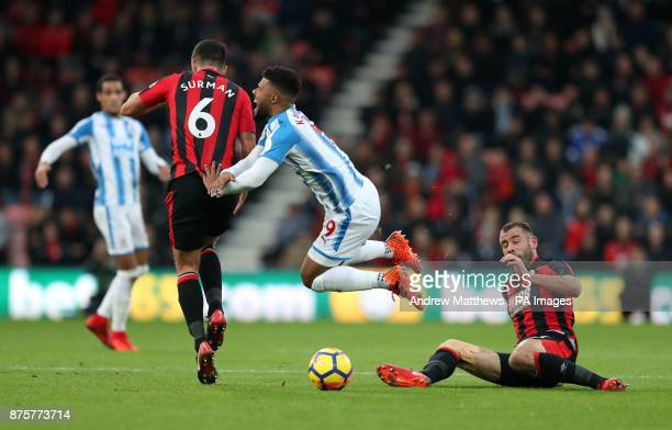 Huddersfield Town's Elias Kachunga is tackled by AFC Bournemouth's Steve Cook during the Premier League match at the Vitality Stadium Bournemouth