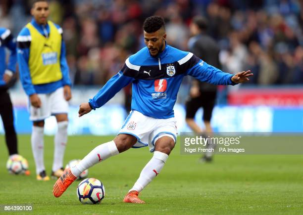 Huddersfield Town's Elias Kachunga warms up before the Premier League match at the John Smith's Stadium Huddersfield