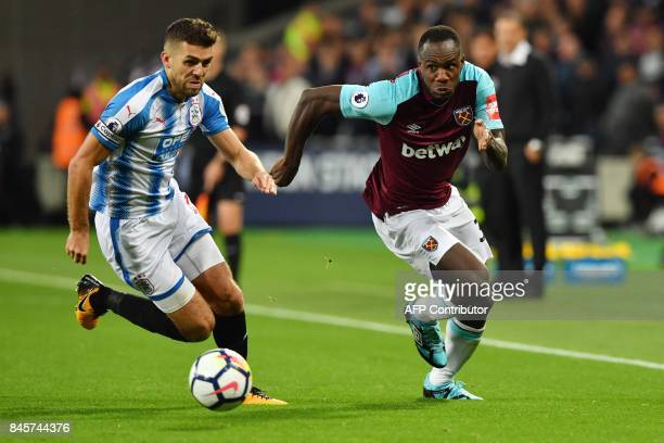 Huddersfield Town's English defender Tommy Smith vies with West Ham United's English midfielder Michail Antonio during the English Premier League...