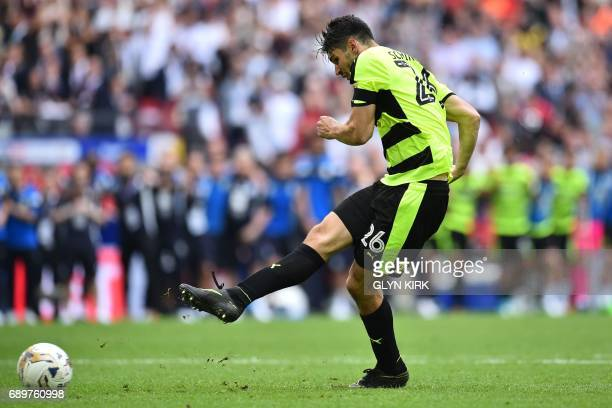 Huddersfield Town's German defender Christopher Schindler scores the final penalty in the shootout during the English Championship playoff final...