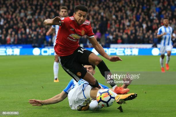 Huddersfield Town's German defender Christopher Schindler tackles Manchester United's English midfielder Jesse Lingard during the English Premier...