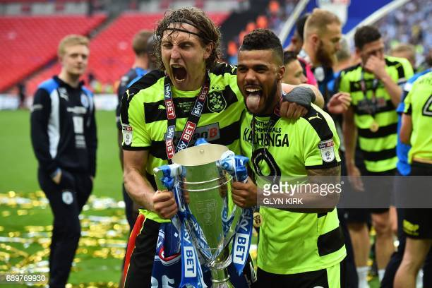 Huddersfield Town's German defender Michael Hefele and Huddersfield Town's Bermudan striker Nahki Wells hold the Championship Playoff trophy as...