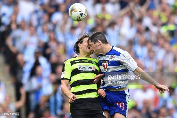 Huddersfield Town's German defender Michael Hefele clashes heads with Reading's French striker Yann Kermorgant during the English Championship...