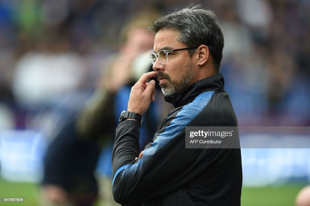 Huddersfield Town's German head coach David Wagner awaits kick off in the English Premier League football match between Huddersfield Town and Leicester City at the John Smith's stadium in Huddersfield, northern England on September 16, 2017. The game finished 1-1. / AFP PHOTO / Oli SCARFF / RESTRICTED TO EDITORIAL USE. No use with unauthorized audio, video, data, fixture lists, club/league logos or 'live' services. Online in-match use limited to 75 images, no video emulation. No use in betting, games or single club/league/player publications. /