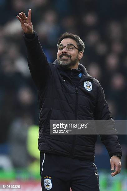 Huddersfield Town's German head coach David Wagner celebrates on the pitch after the English FA Cup fifth round football match between Huddersfield...