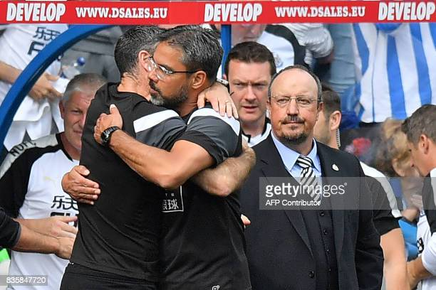 Huddersfield Town's German head coach David Wagner congratulates his team as Newcastle United's Spanish manager Rafael Benitez looks on after the...