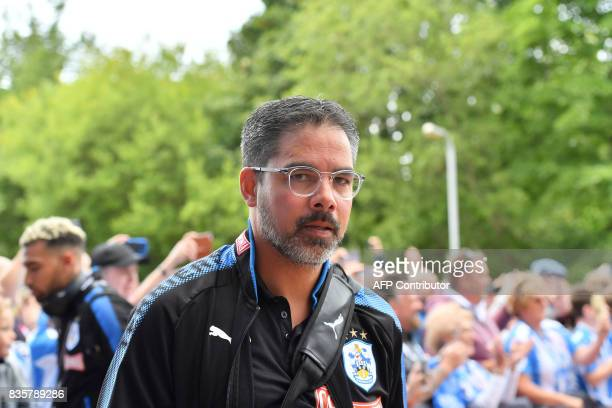 Huddersfield Town's German head coach David Wagner gestures on his arrival prior to the start of the English Premier League football match between...