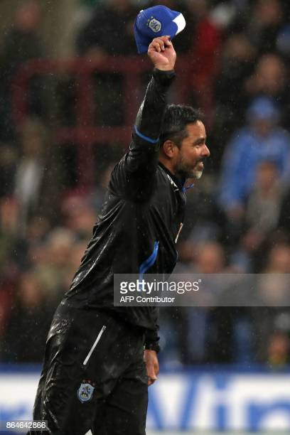 Huddersfield Town's German head coach David Wagner gestures to supporters on the pitch after the English Premier League football match between...