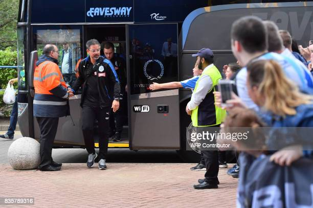 Huddersfield Town's German head coach David Wagner greets supporters on his arrival at the stadium prior to the start of the English Premier League...