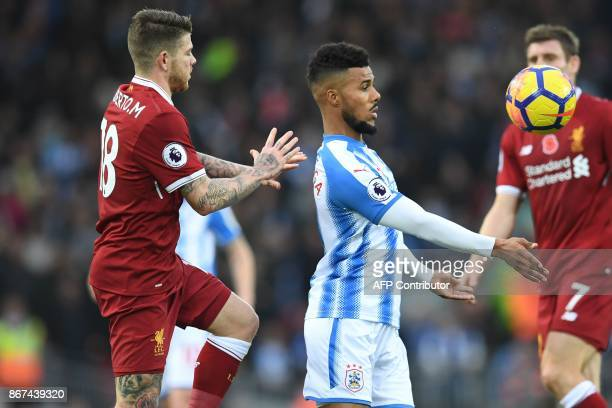 Huddersfield Town's German striker Elias Kachunga controls the ball under pressure from Liverpool's Spanish defender Alberto Moreno during the...