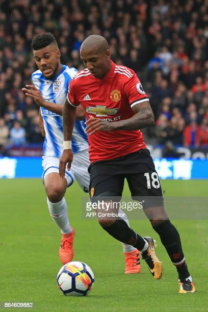 Huddersfield Town's German striker Elias Kachunga vies with Manchester United's English midfielder Ashley Young during the English Premier League...