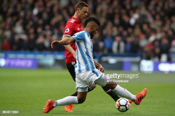 Huddersfield Town's German striker Elias Kachunga vies with Manchester United's Serbian midfielder Nemanja Matic during the English Premier League...