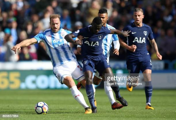 Huddersfield Town's Laurent Depoitre and Tottenham Hotspur's Davinson Sanchez battle for the ball during the Premier League match at the John Smith's...