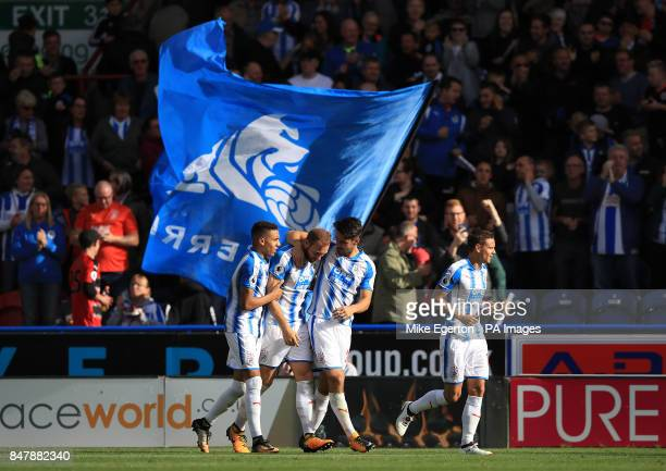 Huddersfield Town's Laurent Depoitre celebrates with his teammates after scoring his side's first goal during the Premier League match at the John...