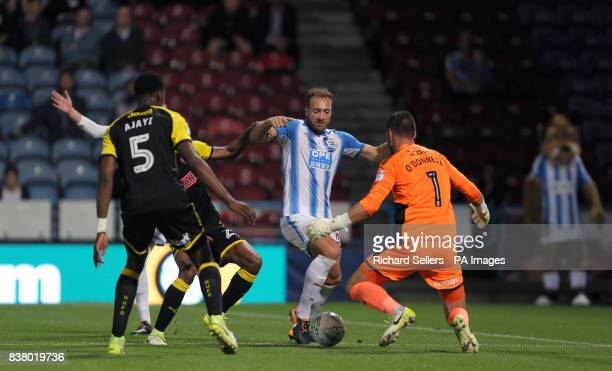 Huddersfield Town's Laurent Depoitre has a shot blocked by Rotherham United goalkeeper Richard O'Donnell during the Carabao Cup Second Round match at...