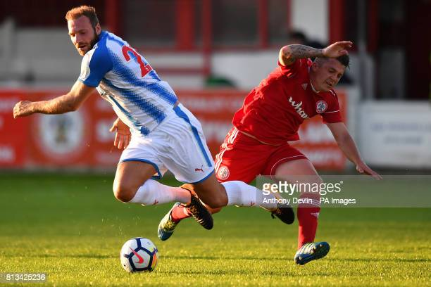 Huddersfield Town's Laurent Depoitre is tackled by Accrington's Scott Brown during the preseason friendly at The Wham Stadium Accrington
