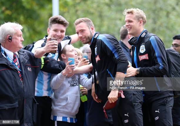 Huddersfield Town's Laurent Depoitre takes a selfie with fans during the Premier League match at the John Smith's Stadium Huddersfield