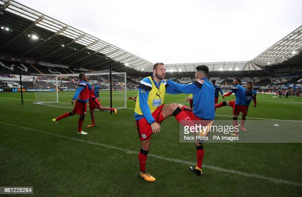 Huddersfield Town's Laurent Depoitre warms up before the Premier League match at the Liberty Stadium Swansea