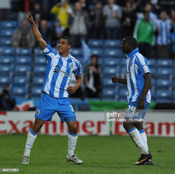 Huddersfield Town's Lee Peltier celebrates scoring their first goal of the game with teammate Benik Afobe
