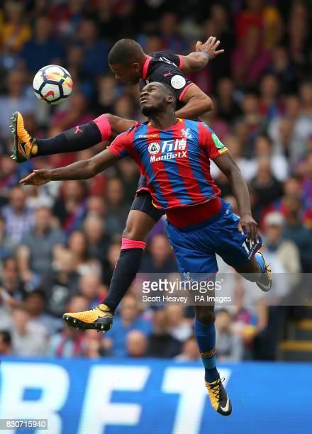Huddersfield Town's Mathias Jorgensen and Crystal Palace's Christian Benteke battle for the ball during the Premier League match at Selhurst Park...