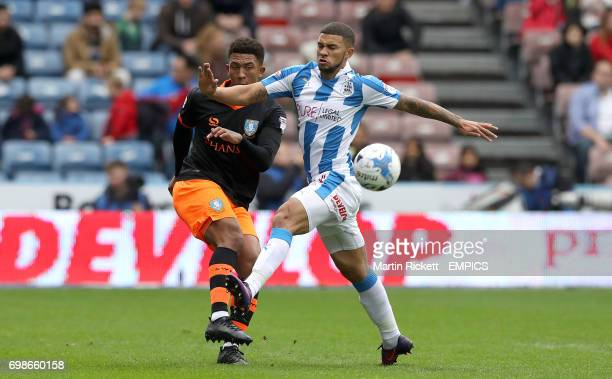 Huddersfield Town's Nahki Wells battles for the ball with Sheffield Wednesday's Liam Palmer