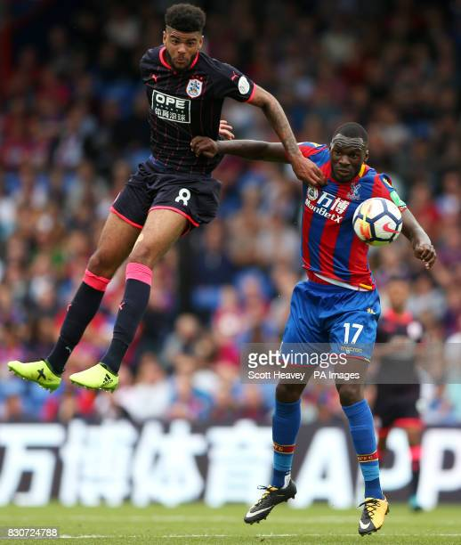 Huddersfield Town's Philip Billing and Crystal Palace's Christian Benteke battle for the ball during the Premier League match at Selhurst Park London