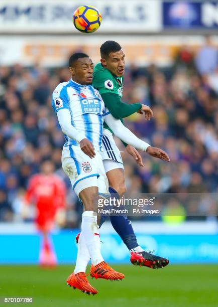 Huddersfield Town's Rajiv van La Parra and West Bromwich Albion's Jake Livermore battle for the ball during the Premier League match at the John...