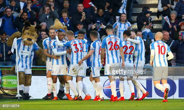 Huddersfield Town's Rajiv van La Parra celebrates scoring his side's first goal of the game with team mates during the Premier League match at the...