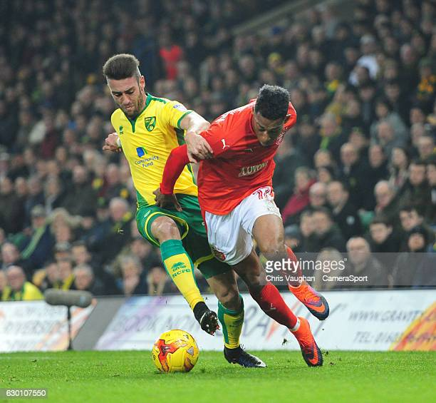 Huddersfield Town's Rajiv van La Parra is fouled by Norwich City's Ivo Pinto during the Sky Bet Championship match between Norwich City and...