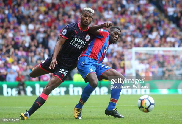 Huddersfield Town's Steve Mounie and Crystal Palace's Timothy FosuMensah battle for the ball during the Premier League match at Selhurst Park London