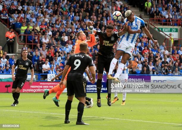Huddersfield Town's Steve Mounie directs a header on goal during the Premier League match at the Kirklees Stadium Huddersfield