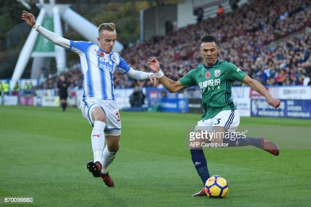 Huddersfield Town's Swiss defender Florent Hadergjonaj vies with West Bromwich Albion's English defender Kieran Gibbs during the English Premier...